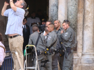 Border police wait for Italian Prime Minister Monti to leave the Holy Sepulchre